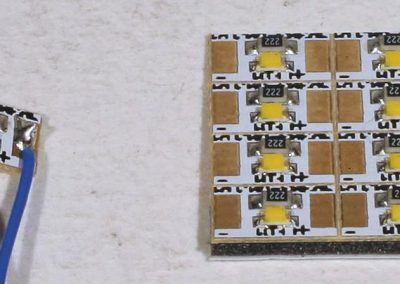 9 - Raccordement de platines d'éclairage cabine MP303 avec des fils bleu (+) et violet (-).