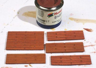 23-Ajustage au cutter de la bordure au niveau de la dépression du quai.